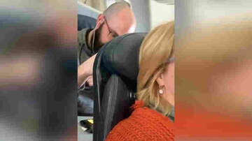 image for Women reclines her seat on a flight and the guy behind her loses it!