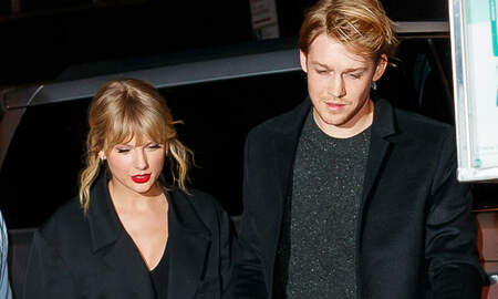 image for Taylor Swift & Joe Alwyn Share A Rare Moment Of PDA At 2020 NME Awards