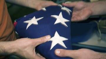 image for WATCH: Delivery Guy Picks Up And Folds Fallen Flag