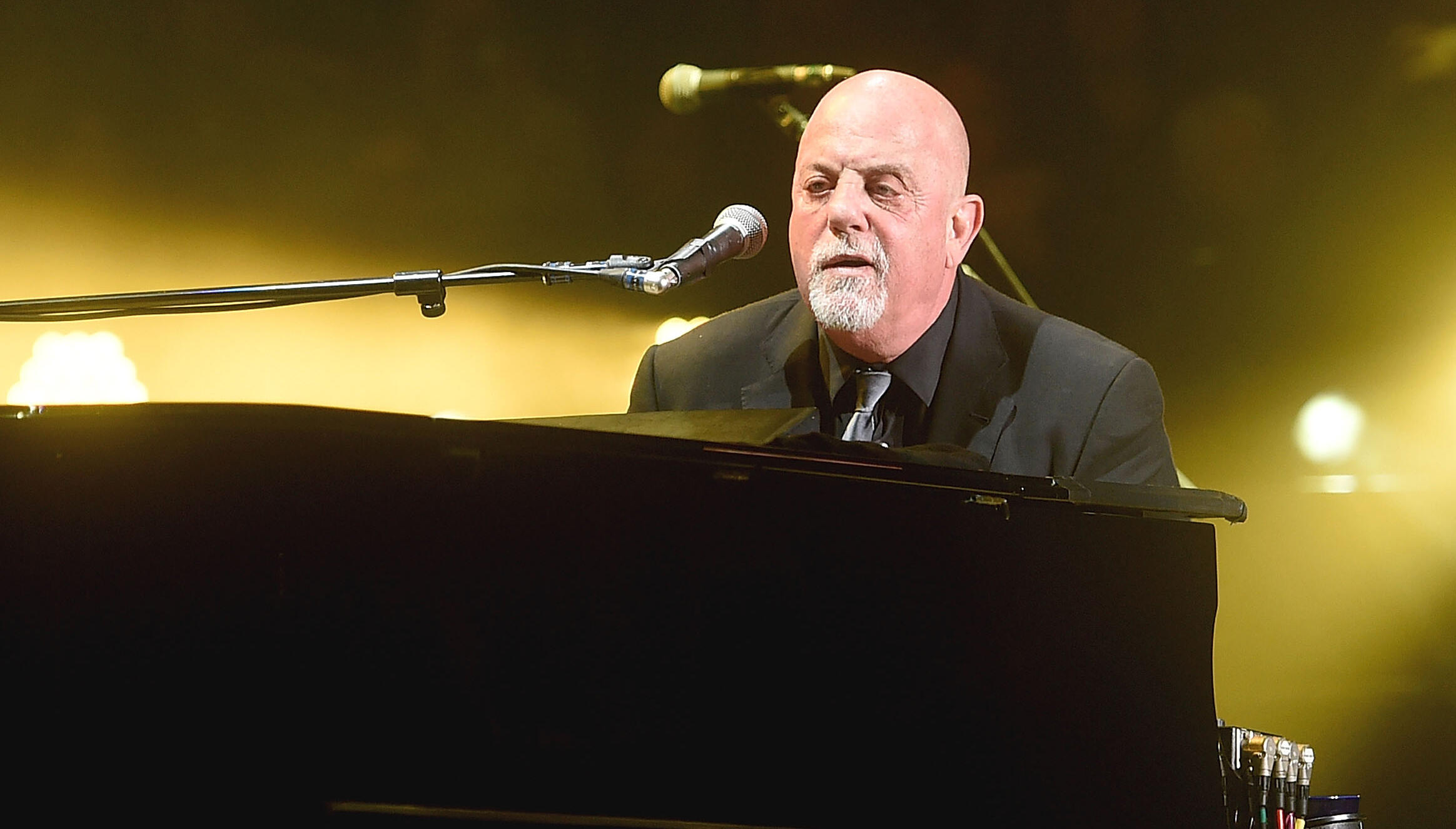 Billy Joel's Neighbors Concerned About Manure Smell From Proposed Stable | iHeartRadio