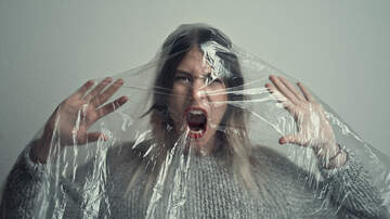 image for Airline Passengers Cover Themselves In Plastic To Avoid Coronavirus -Photos