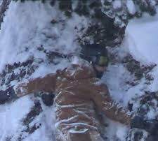 image for  Snowboarder Gets Stuck on Side of Mountain
