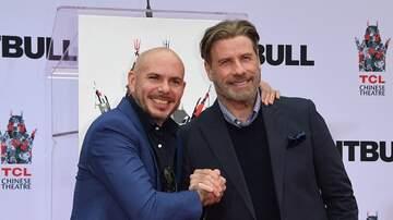 image for John Travolta Joins Pitbull On Stage For Latin TV Performance (VIDEO)