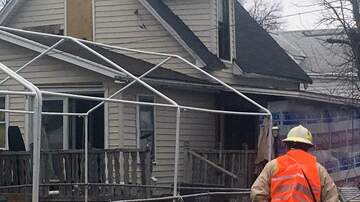 image for Des Moines men try to put out house fire with garden hose