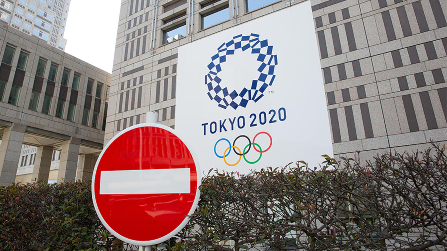 A stop sign in front of the Tokyo Metropolitan Government