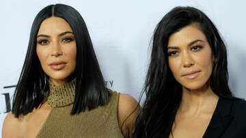 image for Here's What Caused Kim & Kourtney Kardashian's Physical Fight On 'KUWTK'
