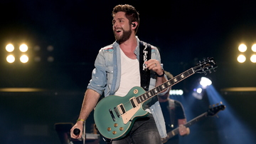 image for Thomas Rhett Take A Tumble While Attempting To Swing On Tree Branch