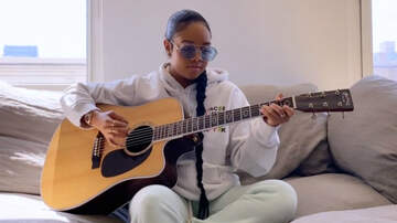 image for H.E.R. Encourages Us To 'Keep Holding On' During Living Room Concert