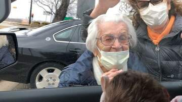 image for Great-grandma meets new grandchild for first time through car window