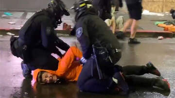 image for Seattle Cop Forcibly Moves Officer's Knee From Neck Of Detained Man