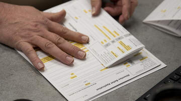 image for Postal Worker Changed Party Affiliations On Absentee Ballot Requests