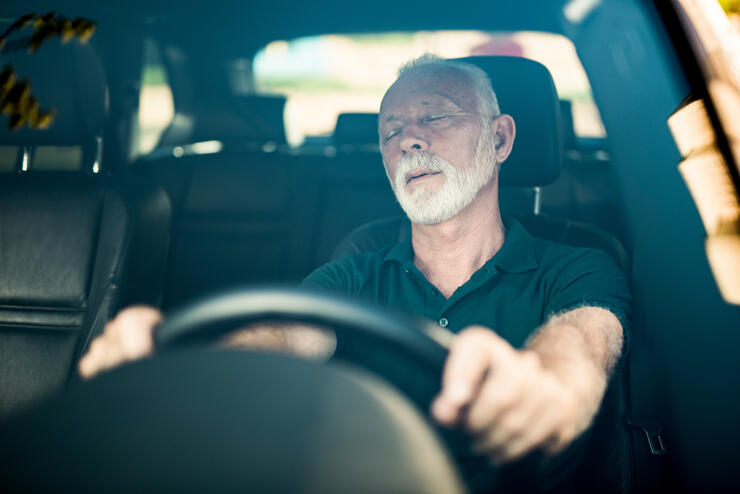 Senior man falls asleep while driving.