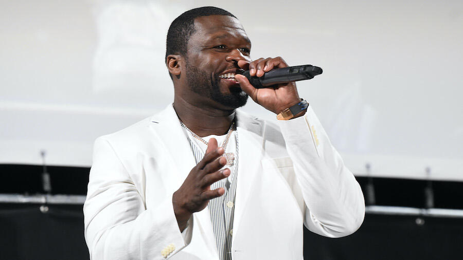 Watch 50 Cent Surprise Burger King Employees With $30,000 In Cash Tips