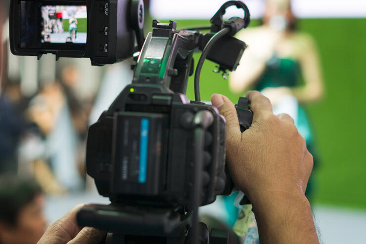 Man Filming People Through Television Camera.Videoand shoot video concept.