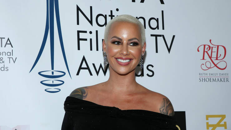 Battle Of The Buzz Cuts... Amber Rose Versus Charlotte B
