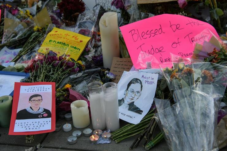 Tributes to late US Supreme Court Justice Ruth Bader Ginsburg are seen at the Supreme Court in Washington, DC