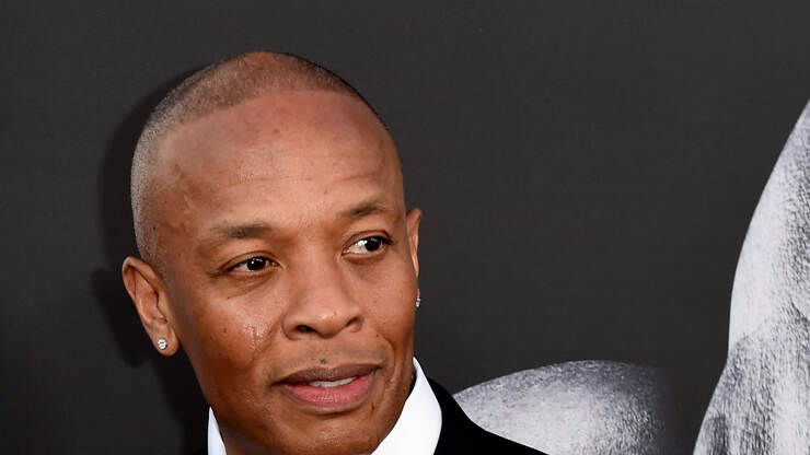 Dr. Dre Shows Off His New Matching Tattoo with His Son. See It Here.