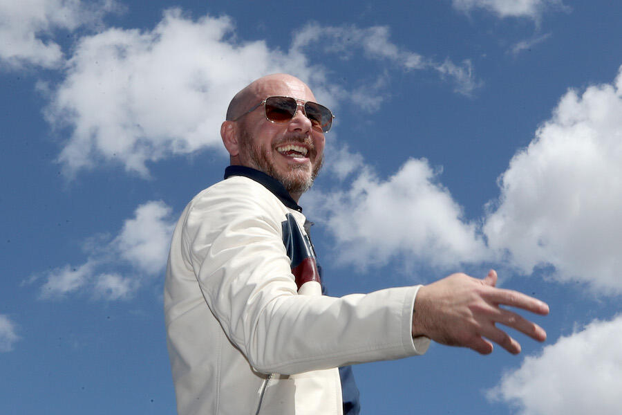 Pitbull Opens Up About Family History & Why Voting Is So Important to Him