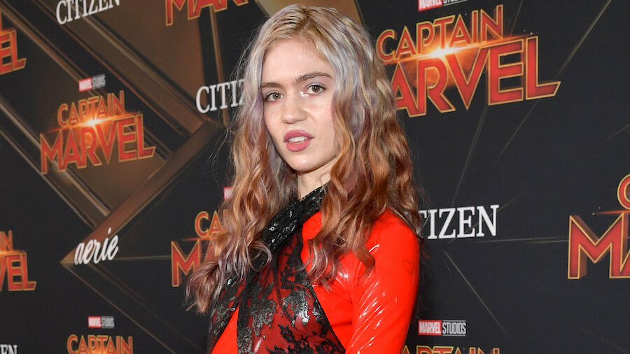 Grimes Says She 'Finally' Has COVID-19, 'Weirdly Enjoying' The Experience