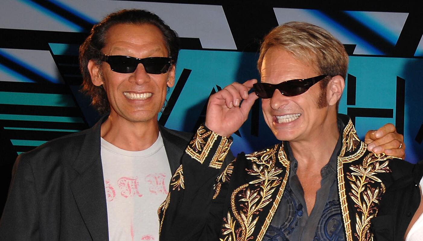 Alex Van Halen Offers Brutally Honest Take On David Lee Roth's Lyrics | iHeartRadio