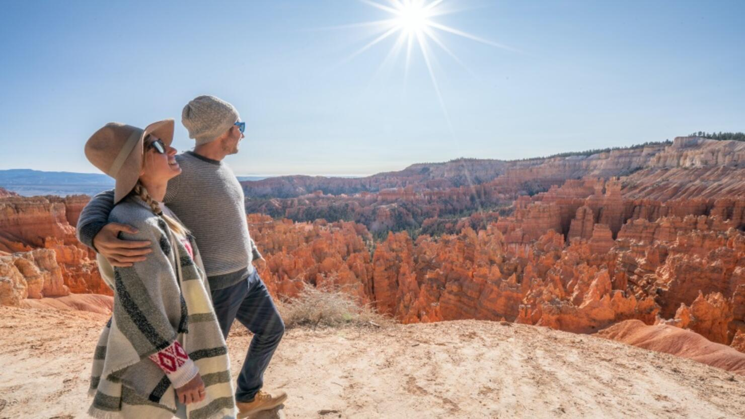 Young couple contemplating nature enjoying travel and adventure - America