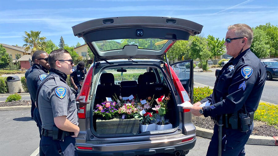 Cops Deliver Mother's Day Flowers After Arresting Delivery Driver For DUI