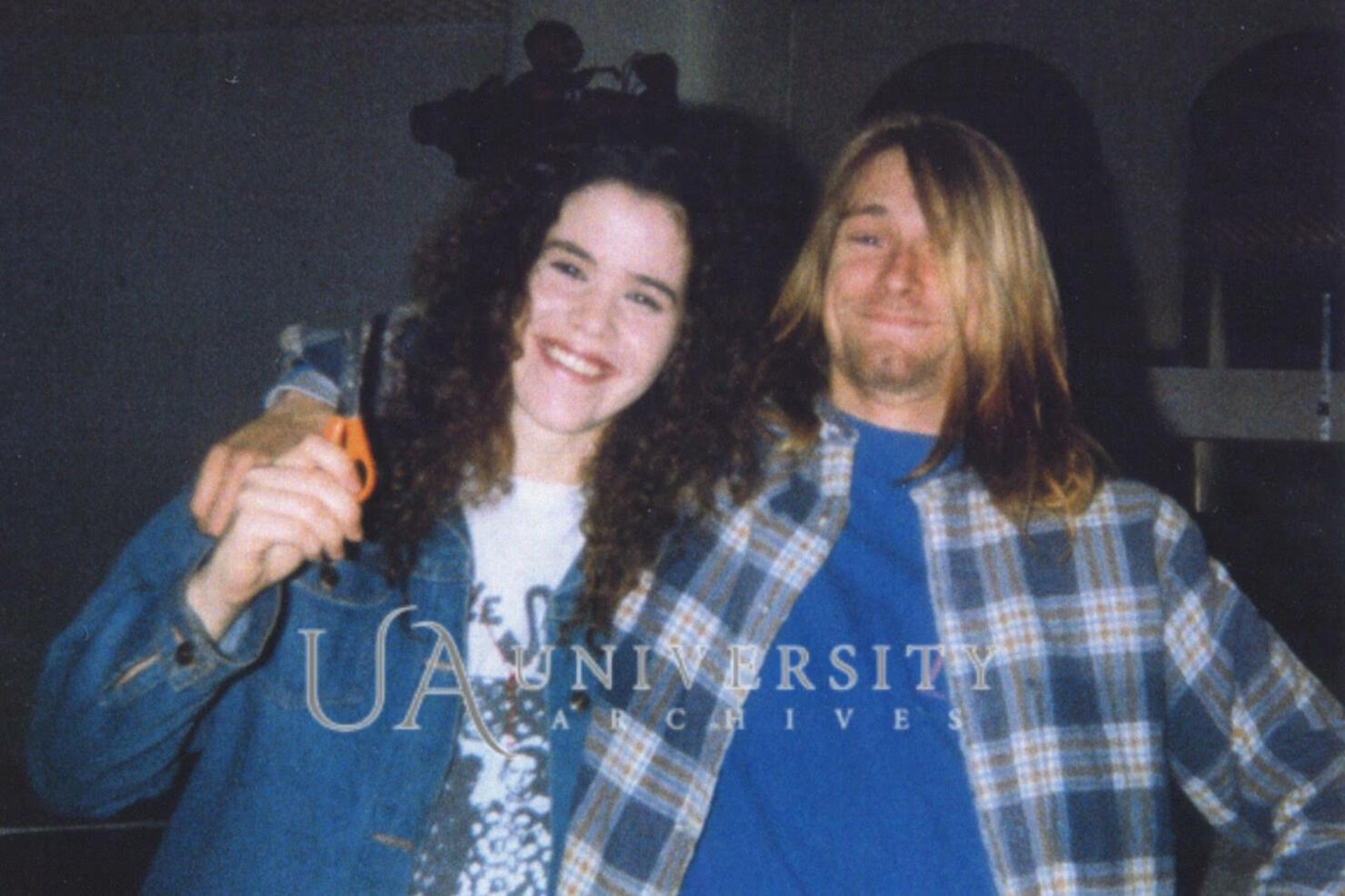 Tessa Osbourne and Kurt Cobain pose during a haircut in 1989