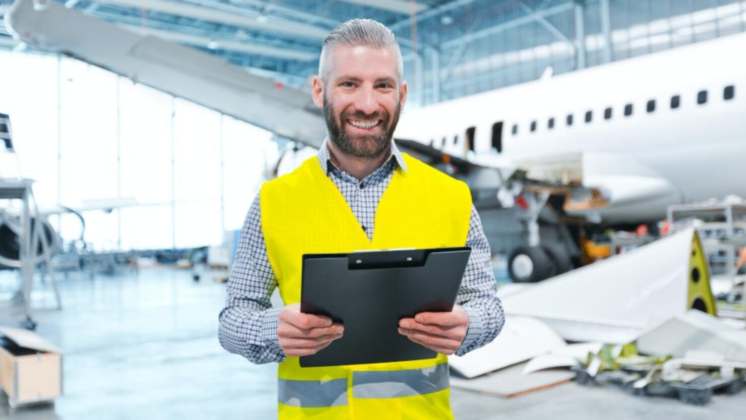 Aircraft inspector in a hangar
