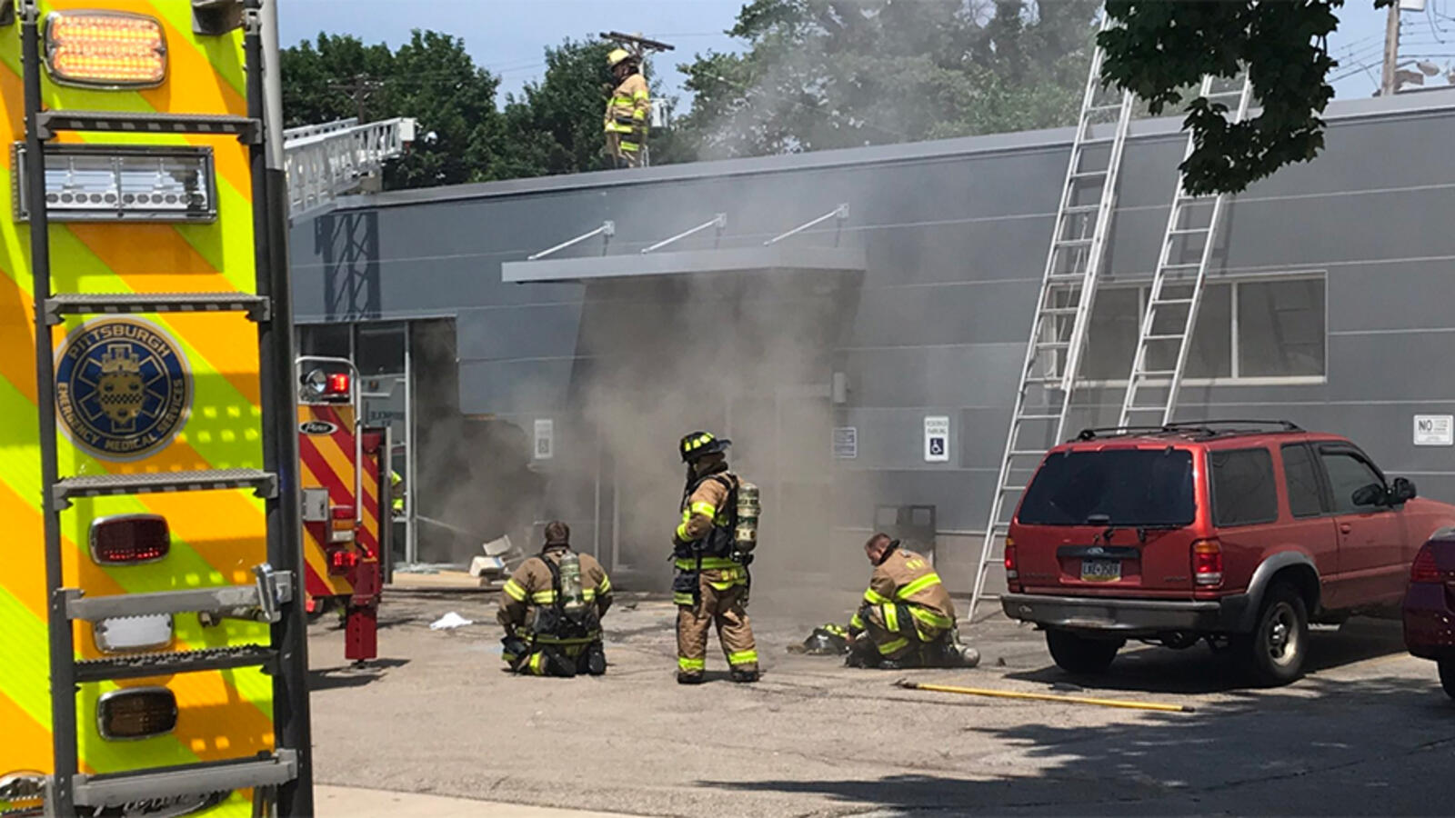 Three Dead After Car Crashes Into Building Causing Fire, Partial Collapse
