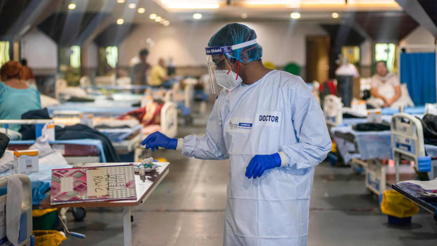 A doctor wearing a Personal Protective Equipment suite (PPE