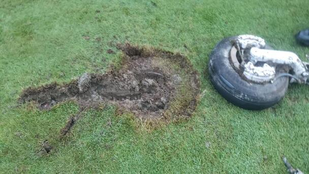 Airplane Landing Gear Falls From Sky, Lands On New England Golf Course