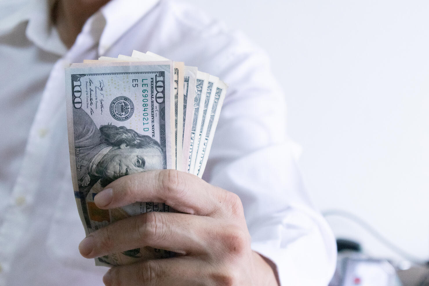 Man holding dollar banknote.young businessman holding money.Business and finances making and saving money concept.