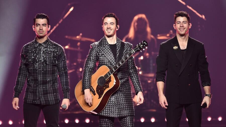 Watch The Jonas Brothers Help Fans Celebrate A Proposal Mid-Concert