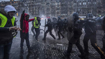 Breaking News - The Latest: French Police Detain 115 People In Paris Protest