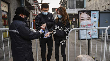 image for China Sees Surge In Coronavirus Cases, Totaling About 60,000