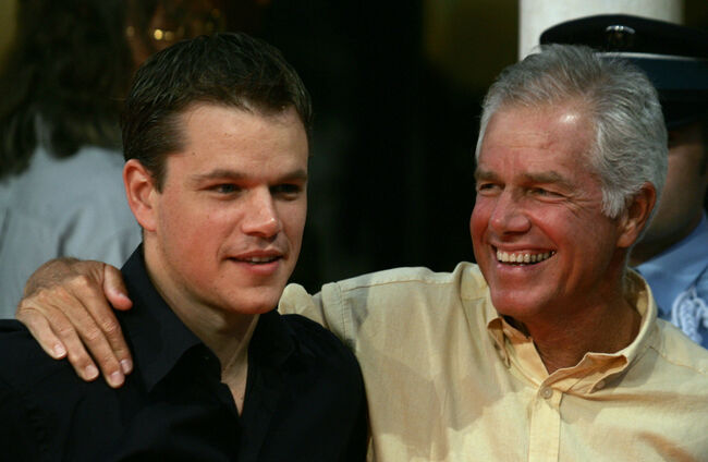 DEAUVILLE, France: American actor Matt Damon (L) poses for photographers with his father as they arrive for the preview of 'The Bourne Supremacy' at the 30th Deauville American film festival in Deauville, 05 September 2004. AFP PHOTO/JEAN PIERRE MULLER (Photo credit should read JEAN PIERRE MULLER/AFP/Getty Images)