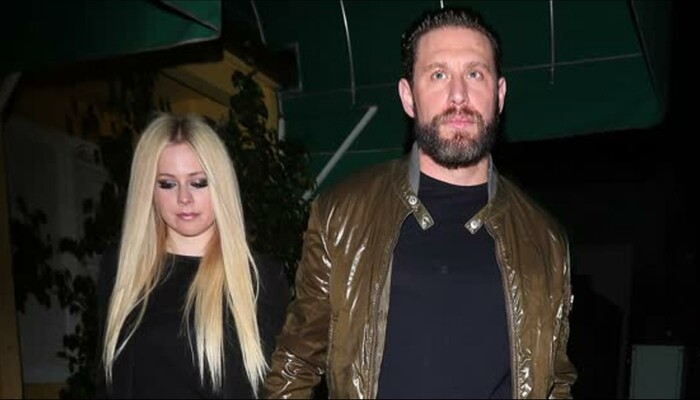 Avril Lavigne Steps Out with Her New Boyfriend on STAR 94.1