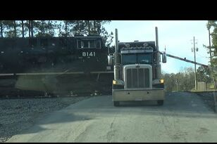 Truck Stopped on Tracks Gets Demolished by Train