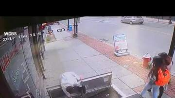 image for WATCH: Woman distracted by phone falls down open door