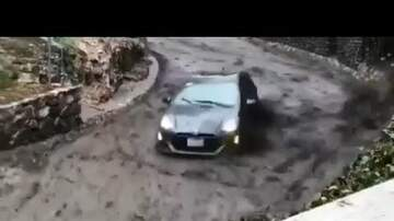 Captain Tony - WATCH: Car Tries To Escape Fast Moving Mudslide