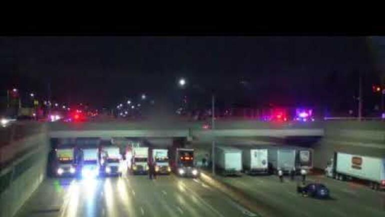 Semis Line Up Under Overpass to Stop Suicide on Michigan Freeway