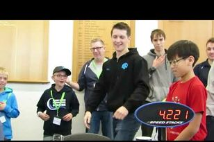 This guy sets a new Rubik's Cube world record & they all miss high fives