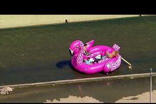 EPIC: Group of Dudes Float Massive Flamingo Raft Down LA River