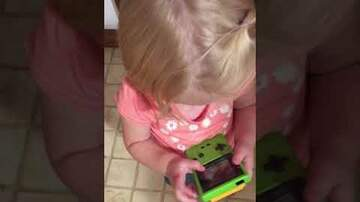 Levi - WATCH: Little Girl trying to play a Gameboy